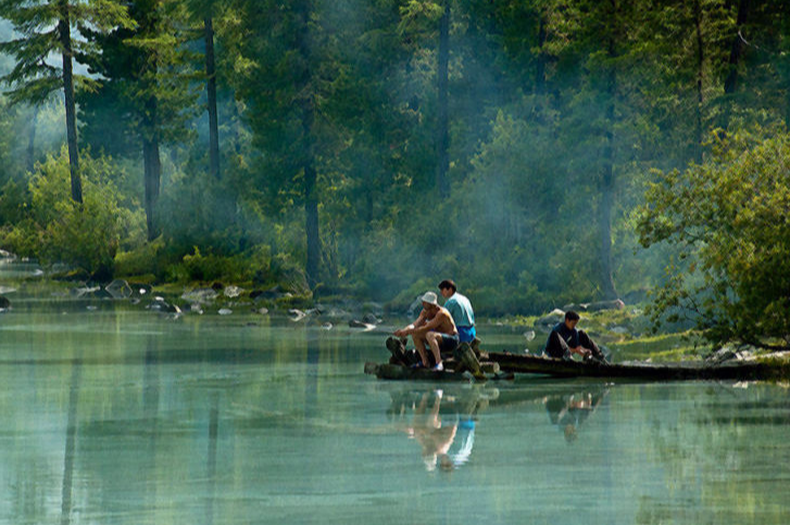 Three Fishermen and a Pond
